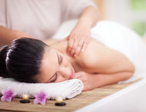 Beautiful woman having a wellness back massage Stock Photography