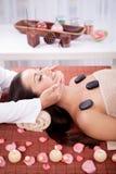 Beautiful woman having a wellness facial massage at spa salon Royalty Free Stock Images