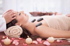 Beautiful woman having a wellness head massage at spa salon Royalty Free Stock Photo