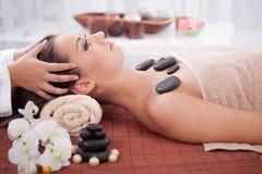 Beautiful woman having a wellness head massage at spa salon Stock Photo