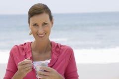 Beautiful Woman Having Yoghurt On Beach Royalty Free Stock Photos