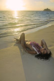 Beautiful woman on a hawaii beach. At sunrise, topless except for her flower lei Royalty Free Stock Photos