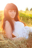 Beautiful woman on the haystack. Royalty Free Stock Image
