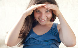 Beautiful woman head shot covering eyes Stock Photo