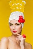 Beautiful woman in headdress decorated with jujube Stock Image