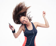 Beautiful woman with headphones in dancing motion Stock Image