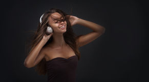 Beautiful woman with a headphones Royalty Free Stock Images