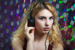 Beautiful woman in headphones have fun and listen music Royalty Free Stock Photography