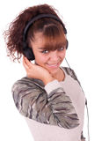 Beautiful woman with headphones, she is listen to the music Royalty Free Stock Images
