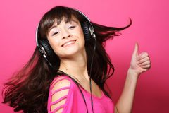 Beautiful woman with headphones Stock Images