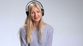 Beautiful woman with headphones listening music stock footage