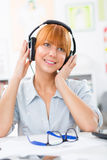 Beautiful woman with headphones listening the music Royalty Free Stock Photo