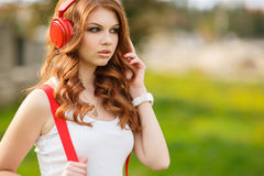 Beautiful woman with headphones listening to music. Stock Photo