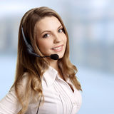 Beautiful woman and headphones with micr. Beautiful young laughing cheerful woman and headphones with microphone stock images