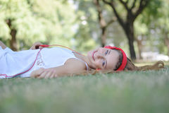 Beautiful woman with headphones in the park. Stock Photography