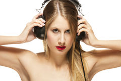 Beautiful woman with headphones spreading her arms Royalty Free Stock Photo