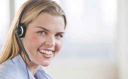 Beautiful Woman with Headset Stock Images