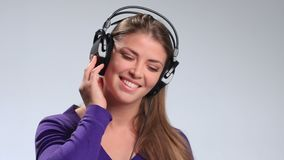 Beautiful woman with headset listening music stock footage