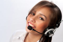Beautiful woman with headset smiling stock image