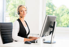 Beautiful woman in headset working in a call center Royalty Free Stock Photos