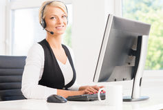 Beautiful woman in a headset working in call center Stock Photo