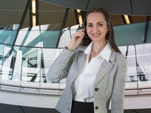 Beautiful woman with headset working in call centre. Portrait Royalty Free Stock Photo