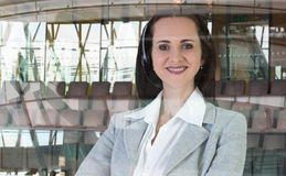 Beautiful woman with headset working in call centre. Portrait Royalty Free Stock Image