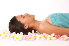 Beautiful woman in health spa amongst frangipanis Stock Photography