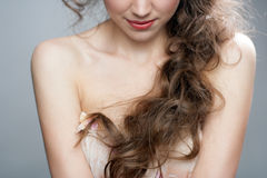 Beautiful woman with healthy Long Curly Hair Royalty Free Stock Photo