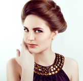 Beautiful woman with healthy pale skin and gray eyes smiling Royalty Free Stock Image