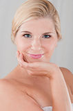 Beautiful woman with a healthy skin. Touching her face Royalty Free Stock Photo