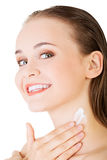 Beautiful woman with healthy skin applying cosmetic cream Stock Image