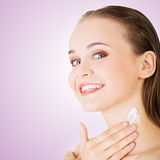 Beautiful woman with healthy skin applying cosmetic cream royalty free stock photos