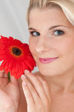 Beautiful woman with a healthy skin and flower Royalty Free Stock Photography