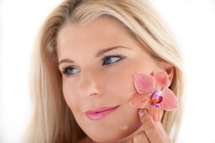 Beautiful woman with a healthy skin and flower Royalty Free Stock Images