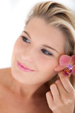 Beautiful woman with a healthy skin and flower Stock Photo