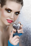 Beautiful woman with heart. Beautiful woman with silver heart and pink lips from 16 bit RAW Royalty Free Stock Image