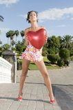 Beautiful woman with heart balloon Valentines Day Stock Photo