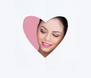 Beautiful woman in a heart cutout Stock Images