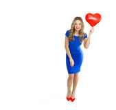 Beautiful woman with heart shaped balloon Stock Photos