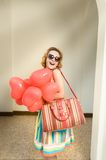 Beautiful woman with heart shaped baloons Stock Photos