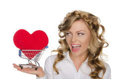 Beautiful woman with heart in shopping cart Stock Image