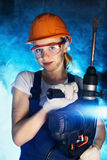 Beautiful Woman With Heavy Drill Stock Images