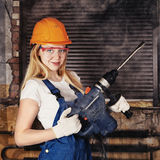 Beautiful Woman With Heavy Drill Royalty Free Stock Images