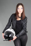 Beautiful woman with helmet in hands Stock Photography