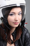 Beautiful woman in helmet on head Royalty Free Stock Photos