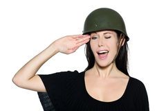 Beautiful woman with helmet soldier saluting Stock Image