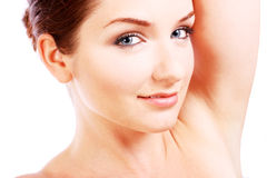 Beautiful woman with her arm up Stock Image