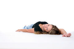 Beautiful woman on her back on the floor Stock Image