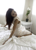 Beautiful woman in her bedroom Royalty Free Stock Photos